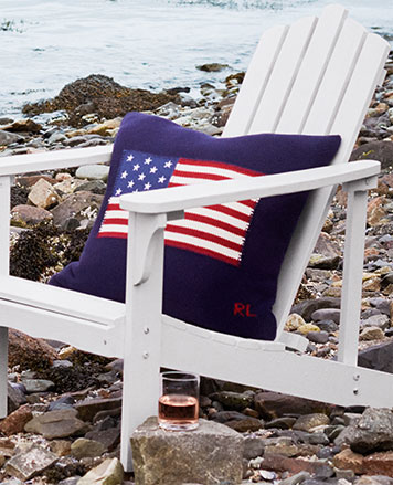 American Flag pillow on white Adirondack chair