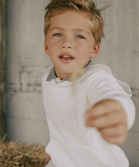 Alternating image of Valentine's Day gifts for boys; boy wears white Polo hoodie.