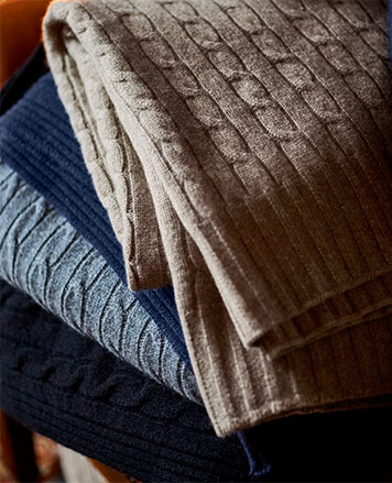 Cable-knit blankets in tan & blue hues
