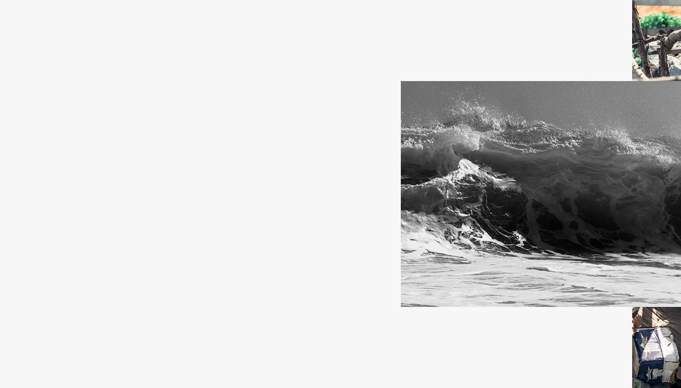 Waves crashing on rocky beach.