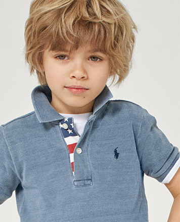 Boy wears faded blue Polo shirt with American flag-inspired placket.