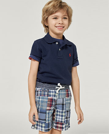 Boy wears patchwork madras shorts with navy Polo shirt.