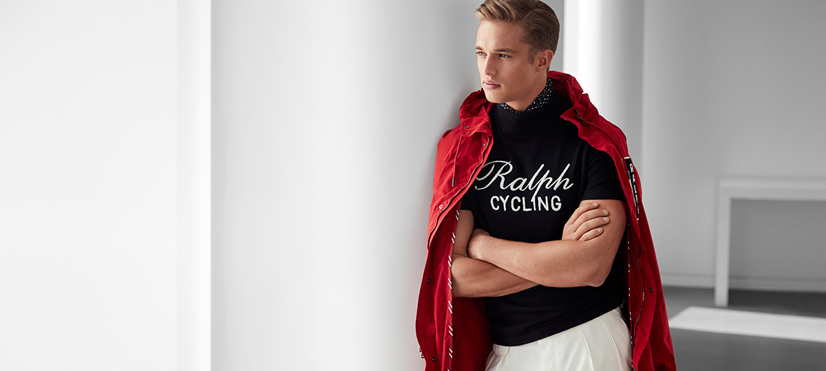 Model in red parka over 'Ralph Cycling' black short-sleeve sweater