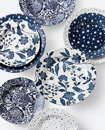 Plates with navy & white floral & star patterns