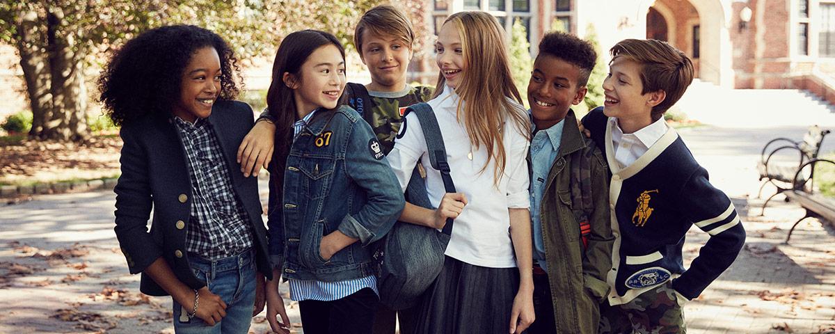 Group of kids in front of school in Polo Ralph Lauren apparel
