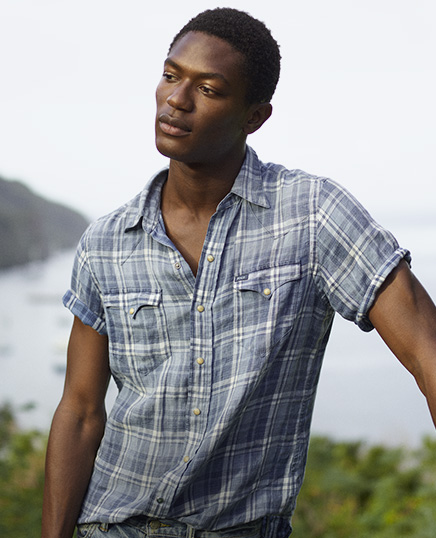 Model in short-sleeve plaid button-down shirt