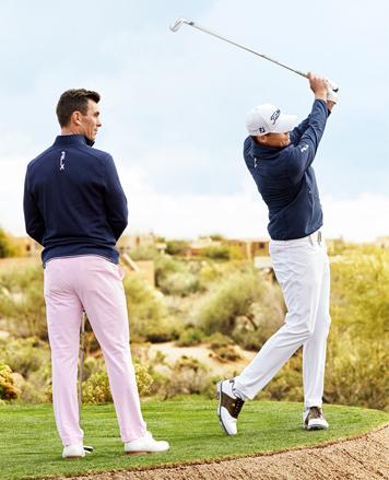 Golfers on green wearing light pink & white pants