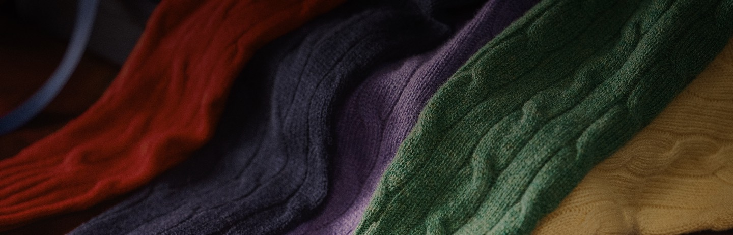 Cable-knit cashmere sweaters in rich colorful hues