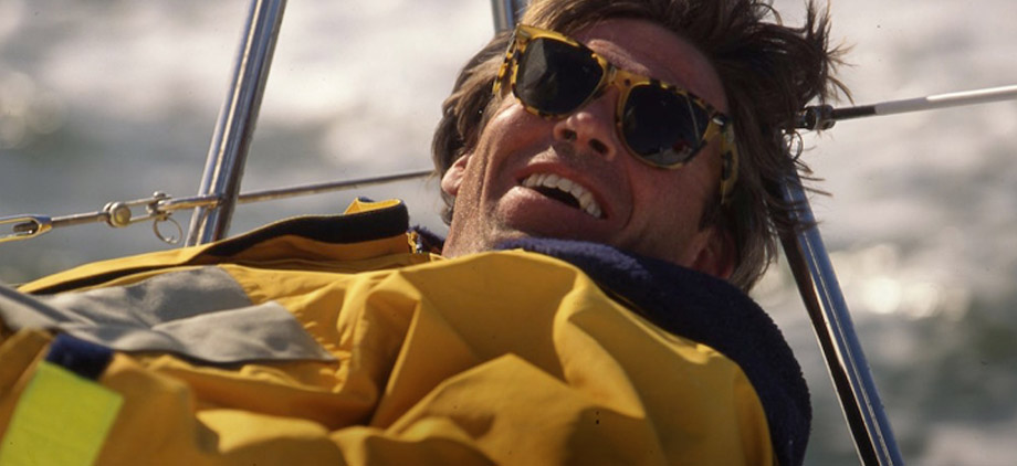Man sailing in yellow anorak & tortoiseshell sunglasses