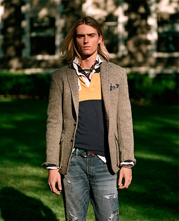 Man in sport coat worn with rugby shirt & distressed jeans