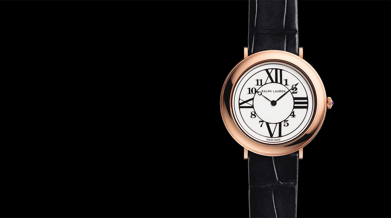 Close-up of rose-gold watch with black alligator wrist strap