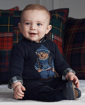 Baby boy wears Polo Bear sweater.