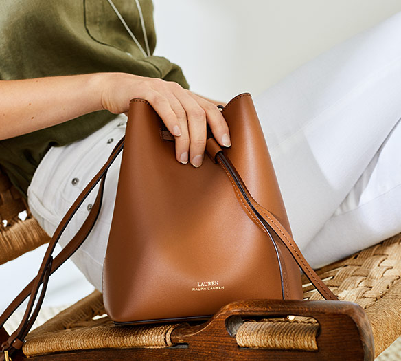 Brown leather tote bag with drawstring top closure   LRL logo SHOP HANDBAGS c322d2f68b