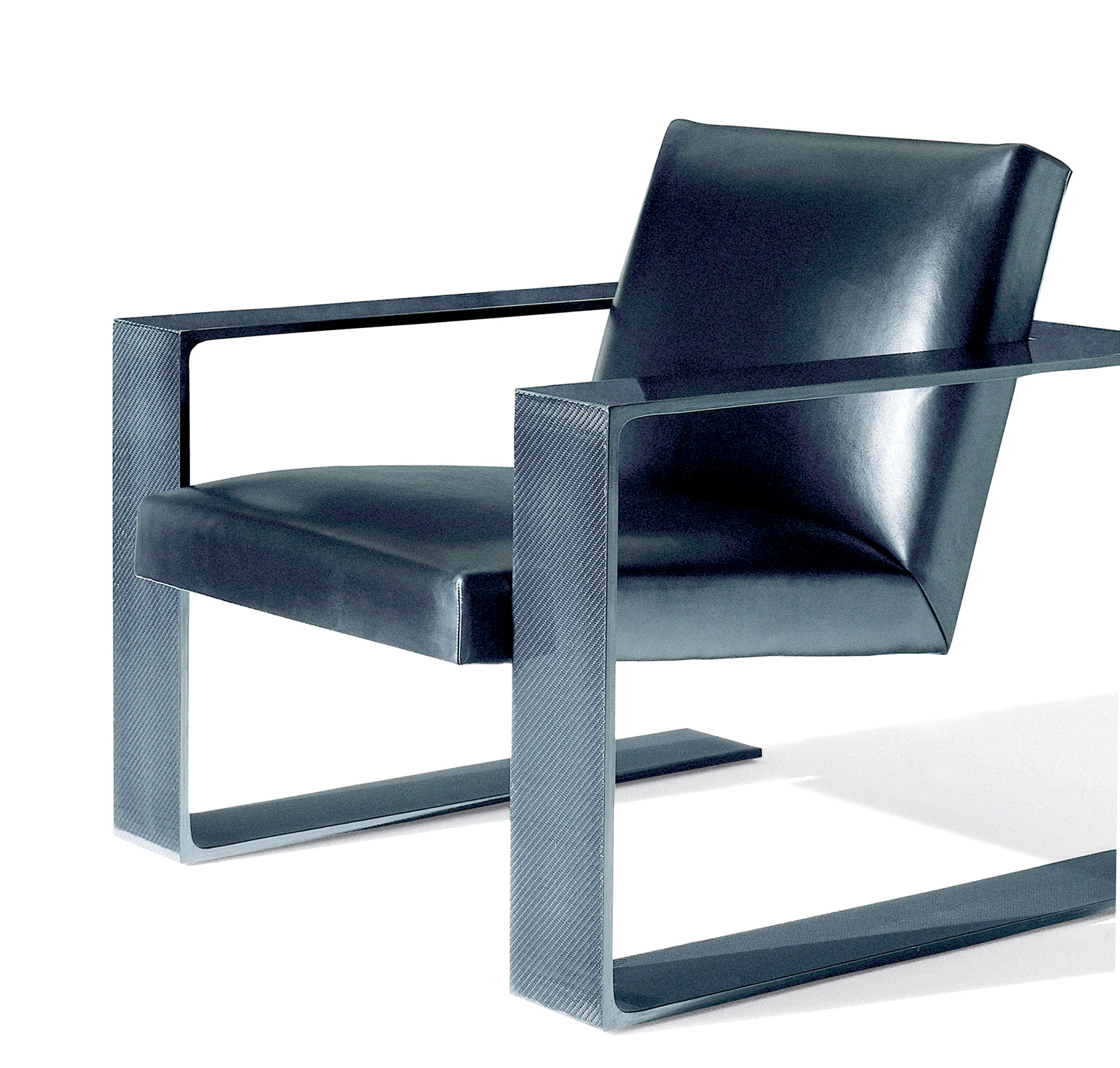 Formed from the same high-tech material that shapes Formula One race cars, the sleek RL-CF1 lounge chair boasts 54 layers of hand-laid tissue carbon