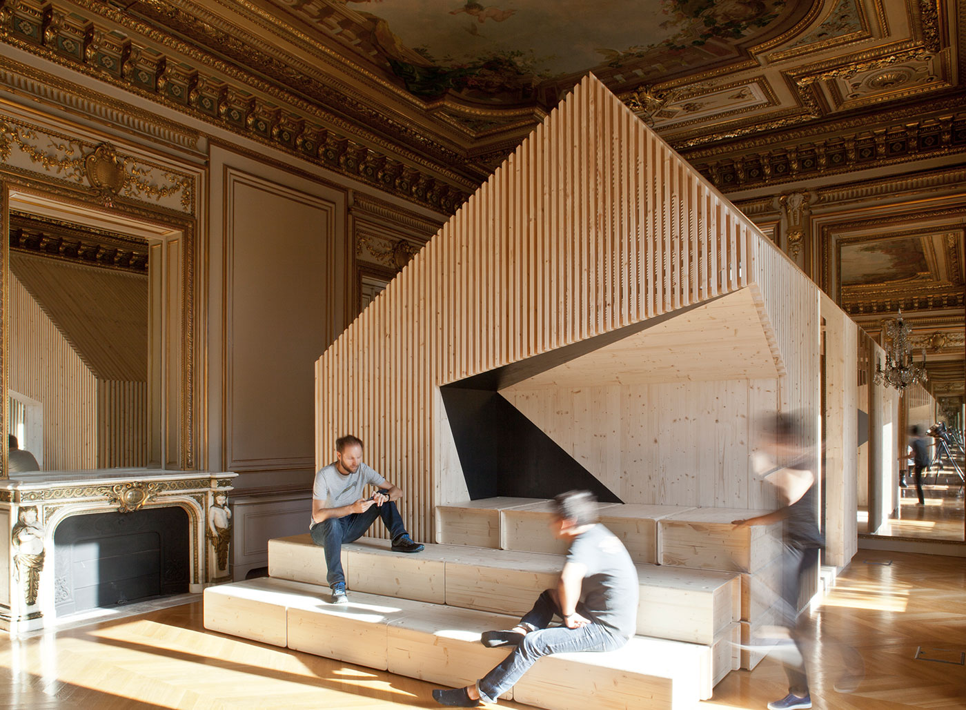 <strong>EKIMETRICS: PARIS | </strong>Estelle Vincent Architecture erected standalone wooden structures to serve as private meeting spaces in the gilded offices of this consulting firm on the Champs-&#xC9;lys&#xE9;es