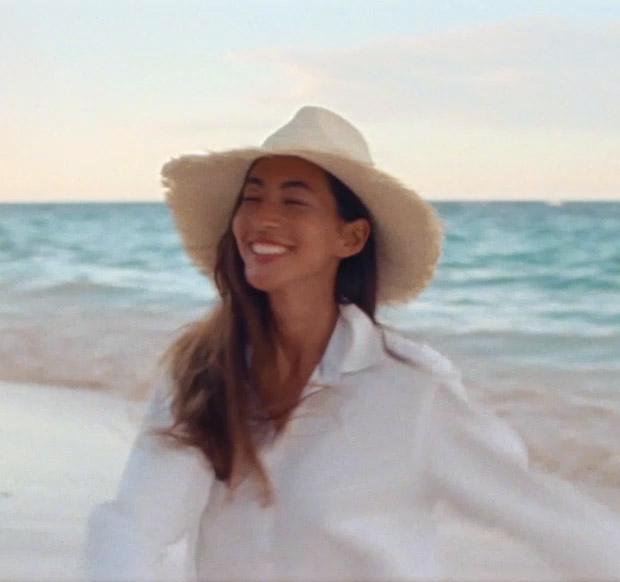 Video of woman in sun hat on beach