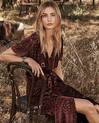 Model in maroon burnout velvet dress