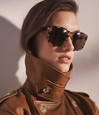 Woman wears tortoiseshell sunglasses