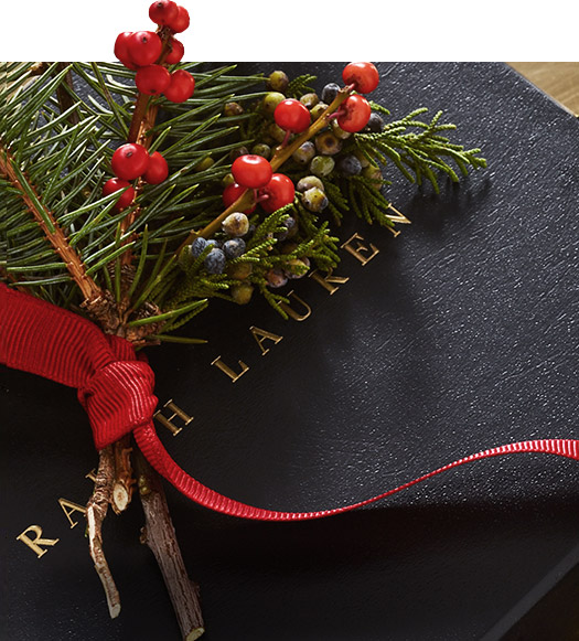 Navy Ralph Lauren gift box topped with sprig of pine & berries