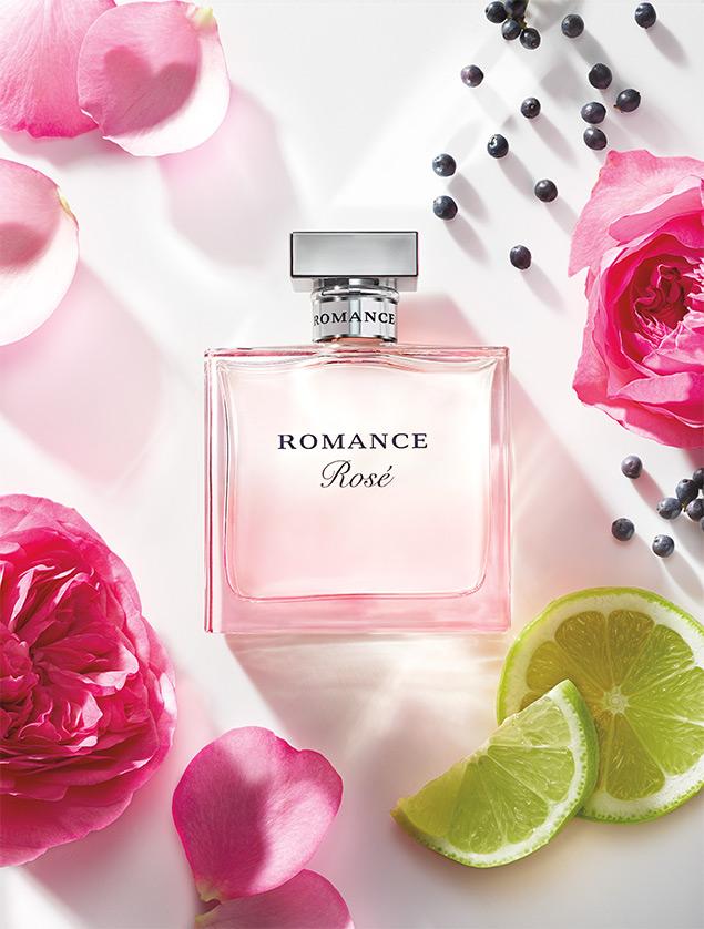 Bottle of Romance Rosé surrounded by florals, bergamot & black currant