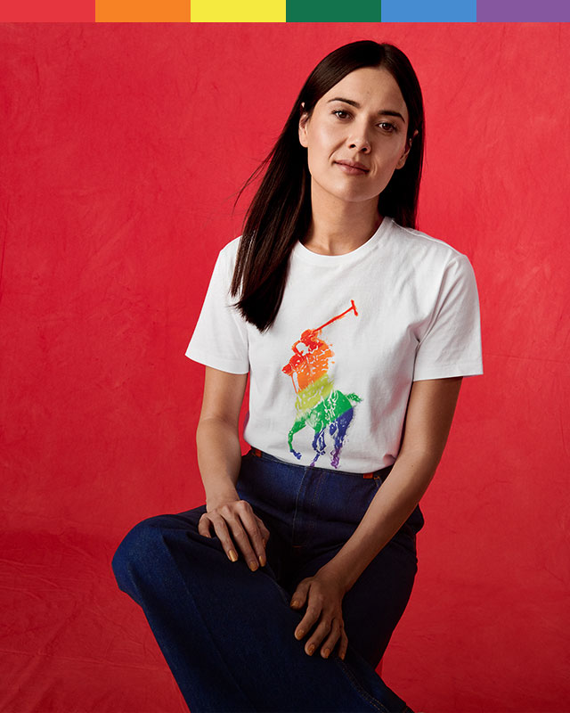 Women, men & youth in white rainbow Pony tees & sweatshirts