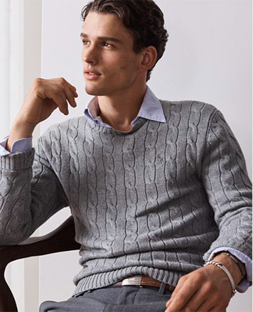 Model in grey cable-knit sweater