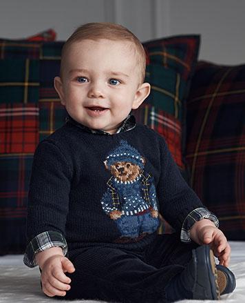 Baby boy wears sweater with Polo Bear in après-ski attire.