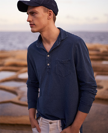 Man in indigo-dyed long-sleeve shirt with four-button placket