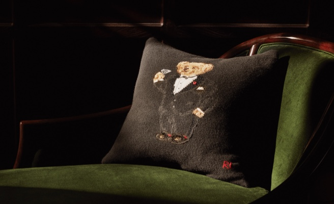 Black cushion with motif of Polo Bear in tuxedo holding martini