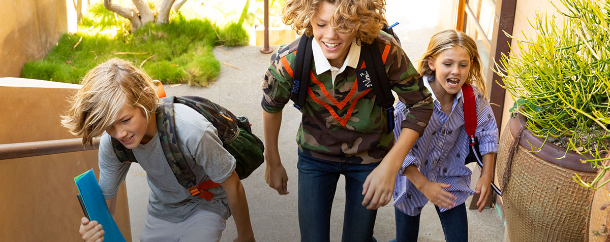 Kids wear backpacks and back-to-school outfits.