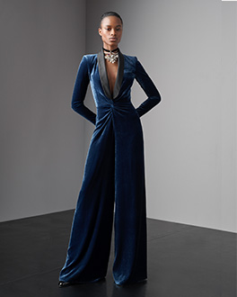 Model in blue suede jumpsuit with black lapels