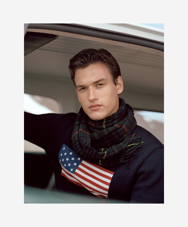 Man in navy American flag sweater
