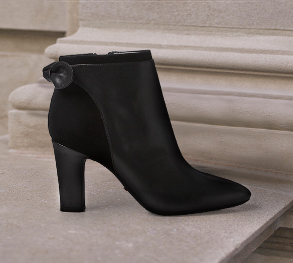 Black boot with heel and bow accent at back
