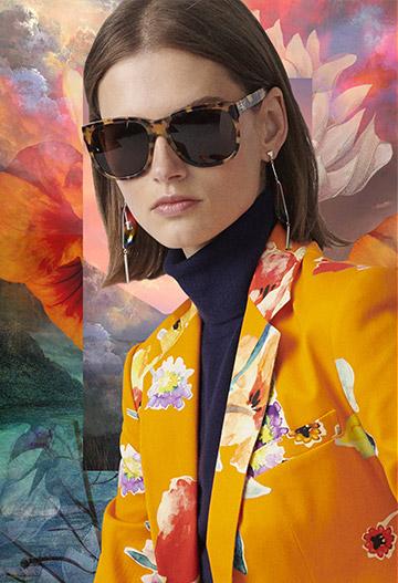 Woman wearing tortoiseshell sunglasses