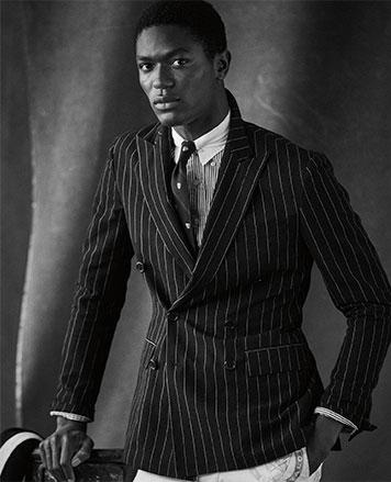 Model in chalk-stripe blazer
