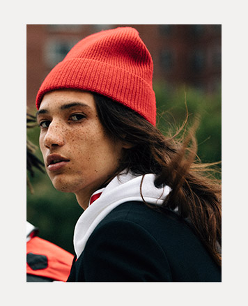 Man in ribbed orange-red knit hat