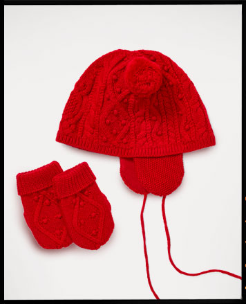 Red knit winter hat with earflaps and mittens.