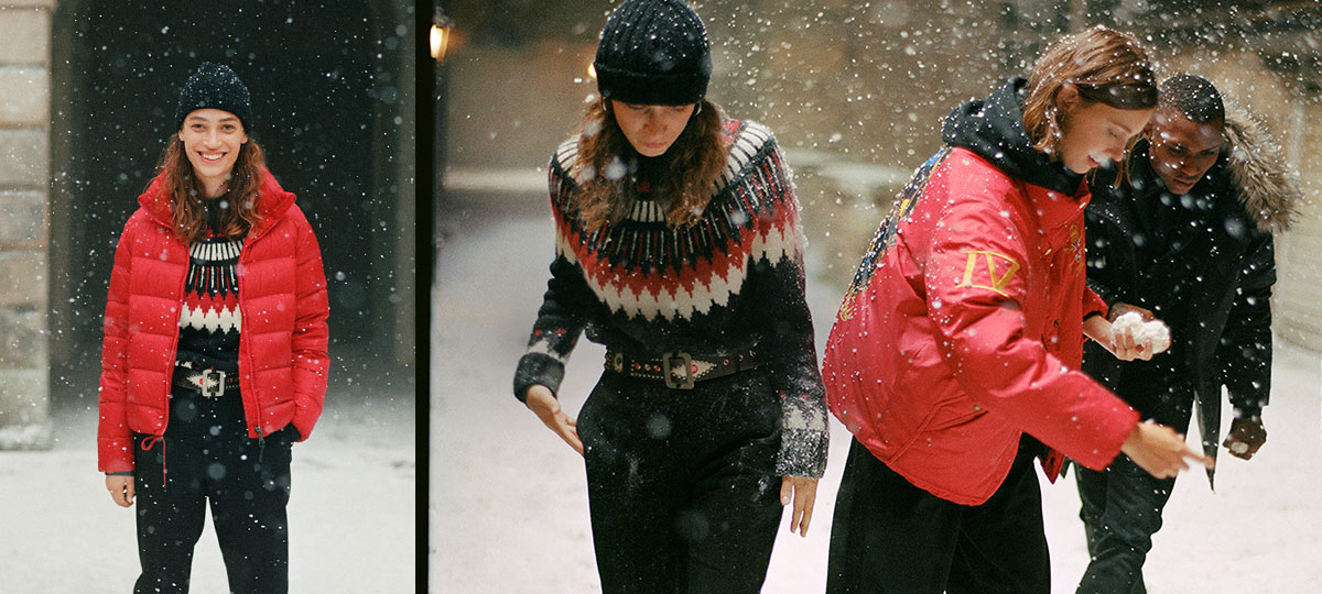 Women in snow in red & black puffers & sweaters