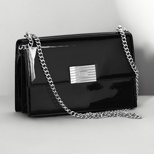 Black patent leather bag with chain strap & engine-turned closure