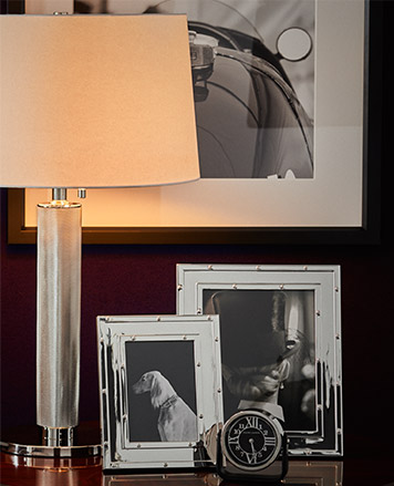 Silver frames and a table lamp.