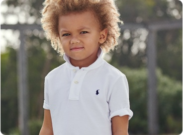 Child in white Polo shirt