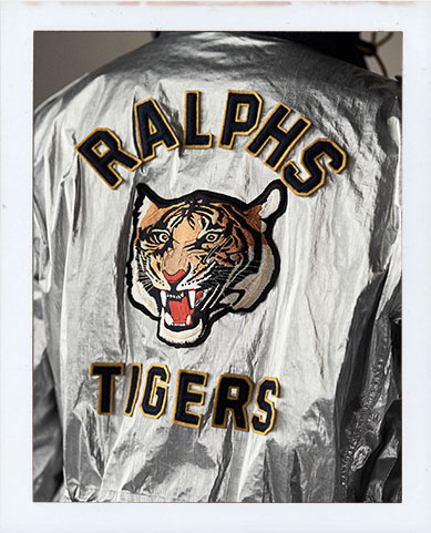 Back of metallic silver jacket with large tiger patch at back