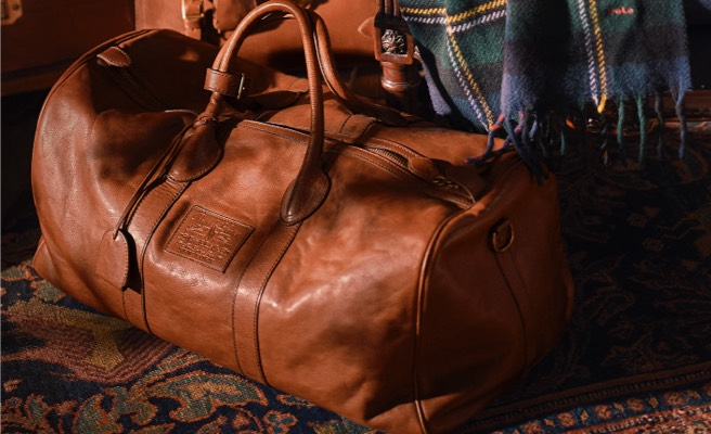 Burnished brown leather bag with two top handles & key bell.