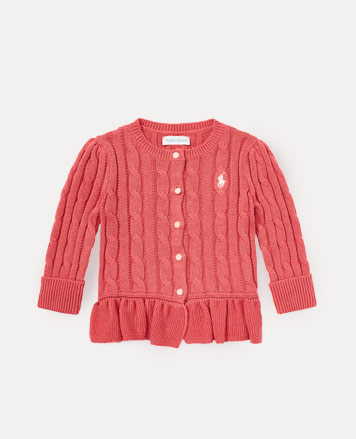 Salmon-colored cable-knit cardigan with ruffled trim.