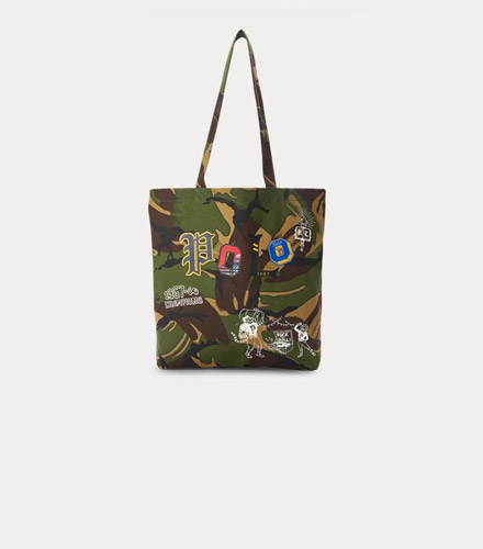 Camouflage tote bag with athletic-inspired patches