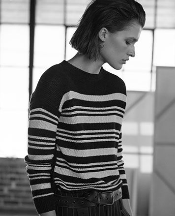 Woman in striped linen sweater