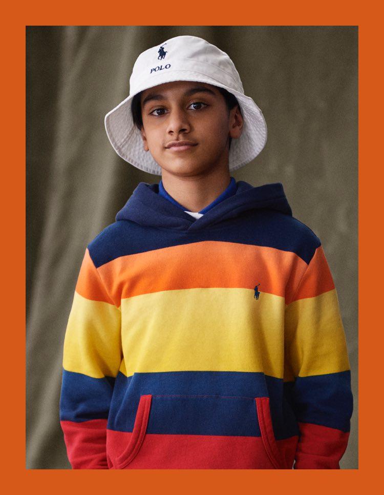 Boy in fisherman hat & multicolored striped hoodie