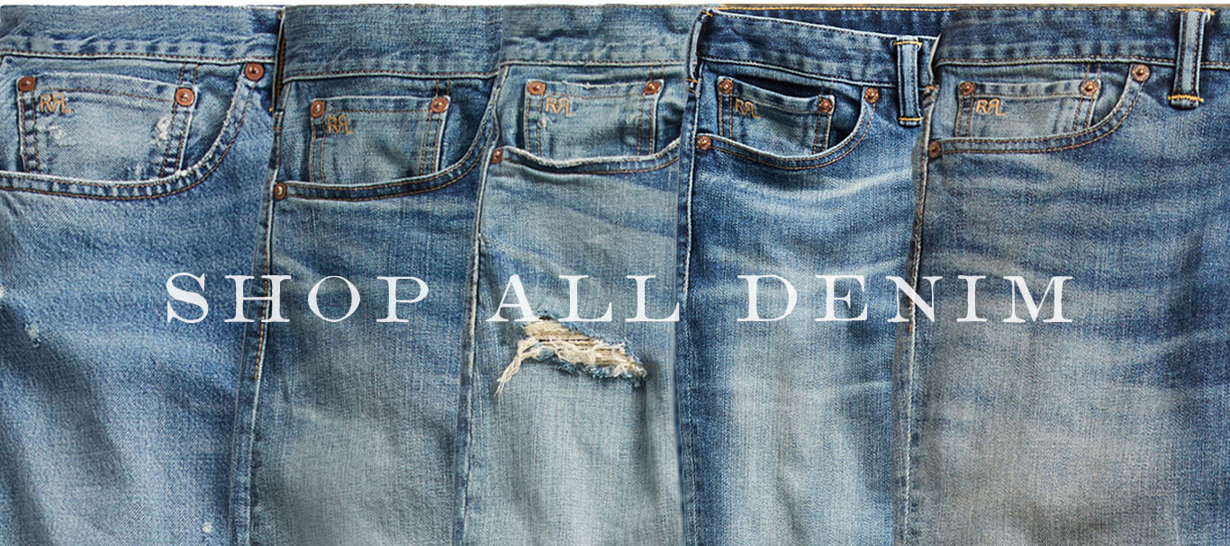 Row of faded, distressed jeans in different washes