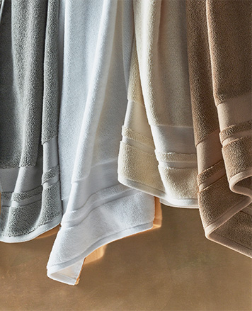 Hanging towels in pastel hues