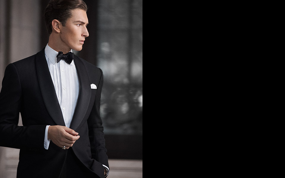 Man in black tuxedo, black bow tie & white bib-front shirt